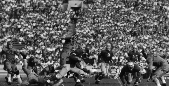 The University of California at Los Angeles after trailing California at Berkeley through the first quarter, finally came into its own at the Memorial Coliseum. In this photo, Kenny Washington, brilliant Bruin halfback, is away to a smashing gain as his teammate, Woody Strode, effectively blocks out the California secondary defense. Dated November 4, 1939