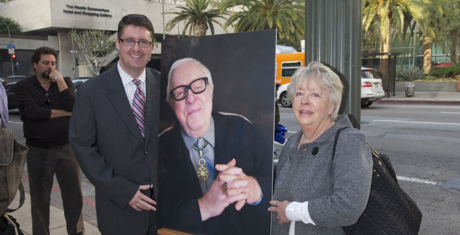 John F. Szabo was holding the intersaction sign of Ray Bradbury Square with other dignitaries and Bradbury family members at a dedication ceremony unveiling the newly designated Ray Bradbury Square at Fifth & Flower Streets by Central Library