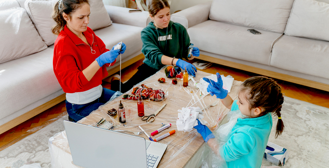 Family making crafts with online tutorial