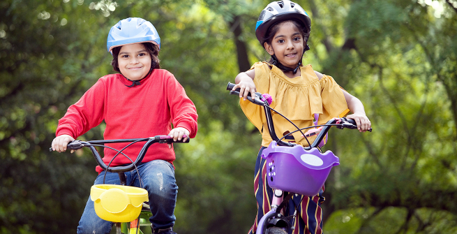 Two kids happy on their bikes