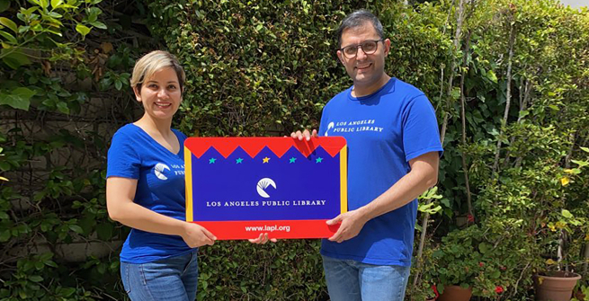 LAPL librarians - Ramin and Toktam holding large LAPL library card