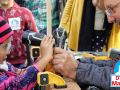 Child and adult with woodworking equipment at DTLA Mini Maker Faire 2018
