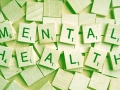 Mental Health spelled out with wood scrabble tiles