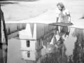 Ethel Schultheis looks into a large fountain