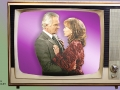 couple inside a vintage television