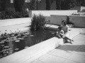 Photo of Woman and Child Sitting By Lily Pond