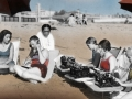1934 colorized picture of people at the beach with typewriters