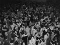 """Couples are dancing to the big band music at the Long Beach Municipal Auditorium's """"Battle of the Bands"""" concert, Horace Heidt vs. Bob Crosby, held Saturday night, April 6, 1942"""