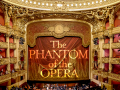 Interior of Palais Garnier Opera House with words The Phantom of the Opera on the curtain.