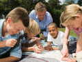 Kids, teens planning a nature exploration in the neighborhood