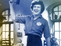Julia Child holding a mallot over her head