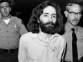 Charles Manson being lead away by deputies