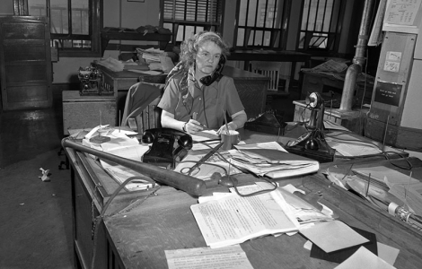 """Agness """"Aggie"""" Underwood at her desk in 1949, two years after becoming the city editor for the Los Angeles Herald and Express. She kept a baseball bat handy in case she needed to keep overzealous Hollywood press agents in line."""