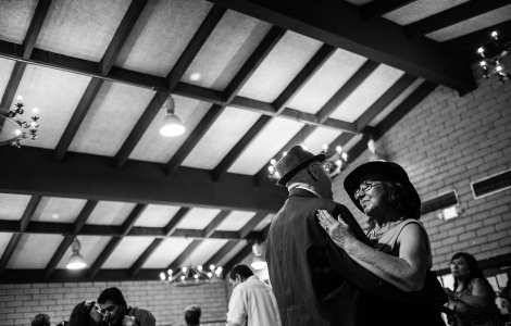 Chuy Hernández (right) shares a slow dance with Olegario Martinez at the Lincoln Heights Senior Center's popular weekly dance. Each Thursday afternoon, Spanish-speaking older adults from LA's Eastside gather for three hours of cumbia, salsa, and boleros.