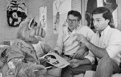 Writer and co-creator Tom Patchett, left, and voice actor Paul Fusco, right, voice are confronted with last-minute script changes from star ALF. Herald Examiner Collection, 1987