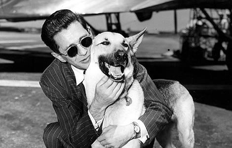 "Blind ex-GI Edward M. Goodman reunited with seeing-eye dog ""Trump"" at United Airport after being separated two months. June 10, 1948"