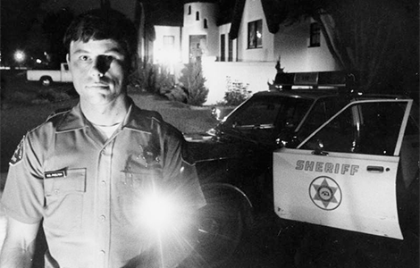 Sheriff's Deputy Bill Phelton is shown during a late night patrol in Temple City, where attacks by the Night Stalker caused rising fear in the community. Michael Haering/Herald Examiner Collection, 1985.