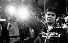 "Dodger pitcher Fernando Valenzuela waves to his adoring fans at the height of ""Fernandomania"" in 1981"
