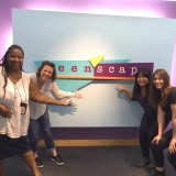 PR Speakers in front of the Teen'sScape sign