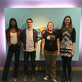 4 librarians in front of the Teenscape sign