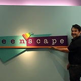 Jorge Ochoa in front of the Teen'Scape sign