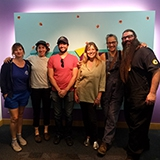 6 artisans in front of the Teenscape sign