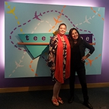 2 therapists writers in front of teenscape sign
