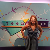 Wende Crowley in front of the teen'scape sign