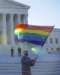 man waving rainbow flag