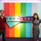 a man and a woman editor in front of the teenscape sign