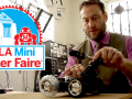 Andrew McGregor working on a project with DTLA Mini Maker Faire logo