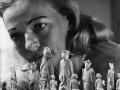 close up of woman staring at a chess board