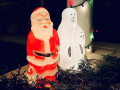 A santa and a ghost decoration on a porch