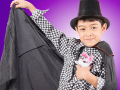A child magician making a stuff bunny disappear