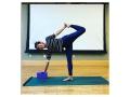 Image shows yoga instructor posing