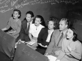 black and white photo of 5 very engaged regular attendees at the Turnabout Theatre in the 1940s